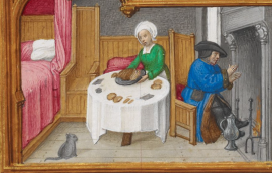 couple by fire, man warming feet, woman serving food